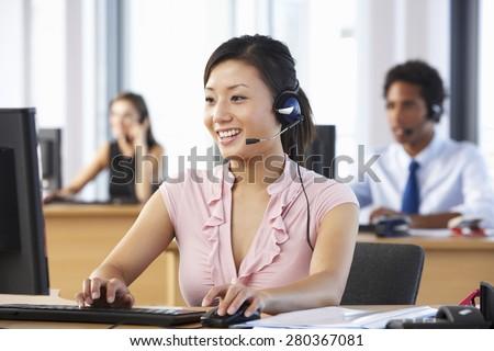 Friendly Customer Service Agent In Call Centre - stock photo