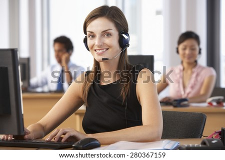 Friendly Customer Service Agent In Call Centre - stock photo