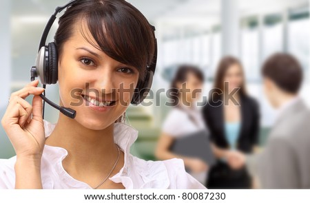 Friendly customer service consultants working - stock photo