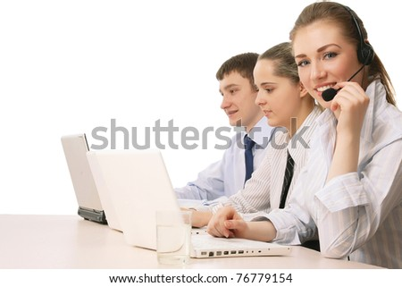 Friendly customer service consultants working, focus on a young girl - stock photo