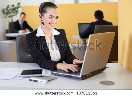 Friendly customer service employee working in the office - stock photo