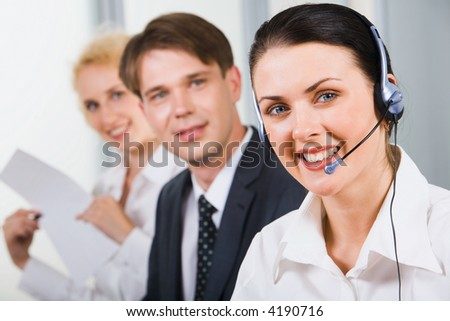 Friendly customer support team in an office environment - stock photo