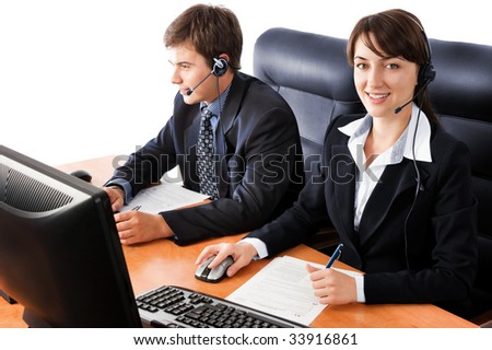 Friendly customer support team working at the office, against a white background