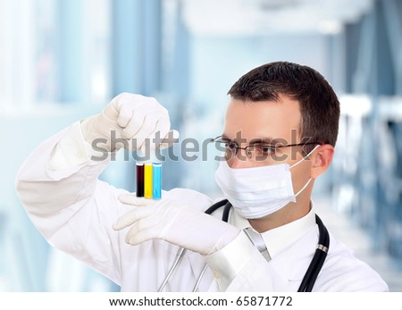 Friendly doctor in mask resarch a medical test glass . - stock photo