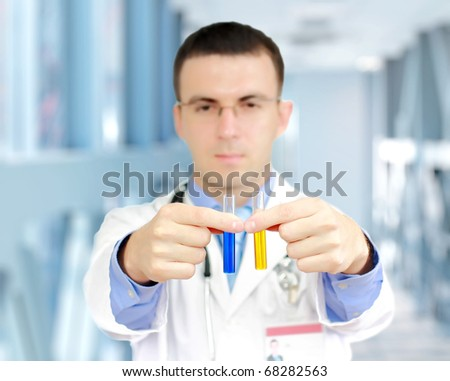 Friendly doctor -intern research a medical test glass - stock photo