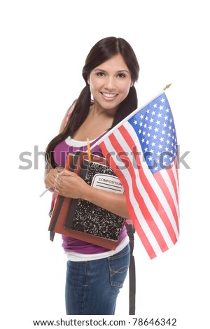 Friendly ethnic Latina woman high school student standing holding American flag - stock photo