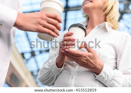 Friendly family has talking with hot drink - stock photo