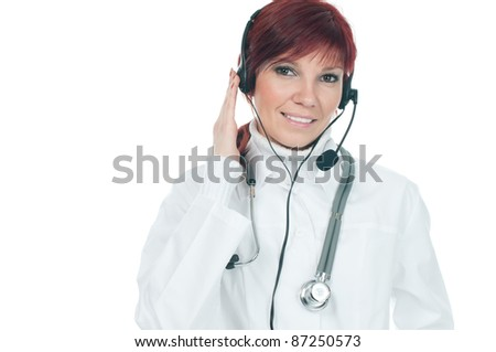 Friendly female caucasian doctor in headset isolated over a white background, medical support phone operator concept - stock photo