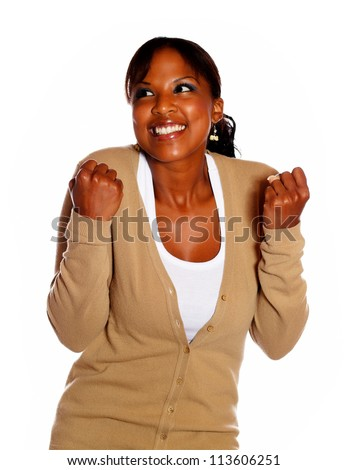 Friendly female celebrating a victory against white background