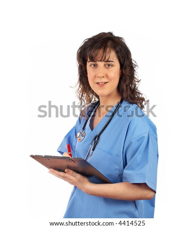 Friendly female doctor in blue scrubs, writing on white background - stock photo