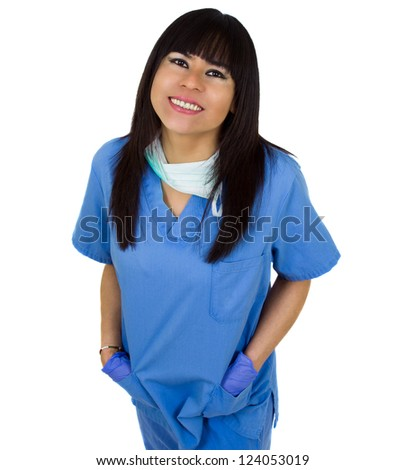 Friendly female doctor smiling with her hands in pockets - stock photo