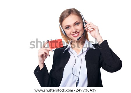 Friendly female helpline operator showing blank credit card over white background - stock photo