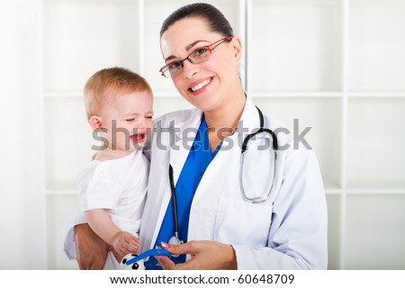 friendly female pediatrician and baby girl - stock photo