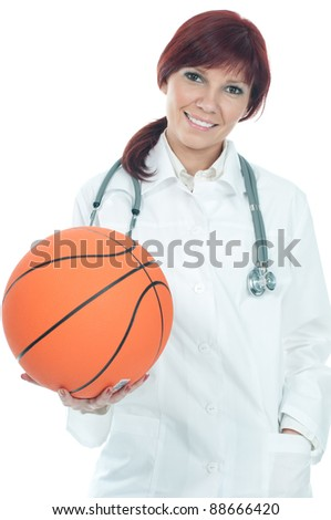 Friendly female practitioner holding a basketball, smiling and looking at camera, white background - stock photo