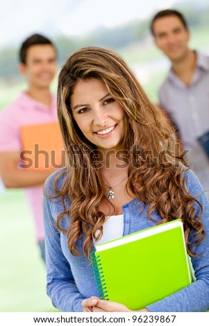 Friendly female student looking happy and smiling