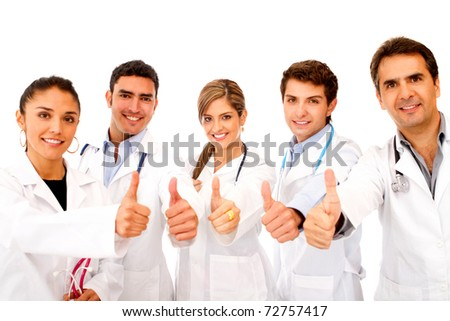 Friendly group of doctors with thumbs up - isolated over white - stock photo