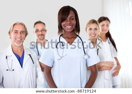 Friendly group of successful happy multi-ethnic doctors smiling at the camera