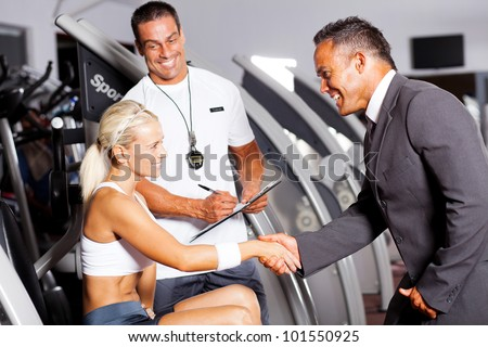 friendly gym manager greeting customer - stock photo