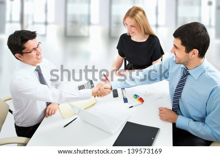 Friendly handshake on business meeting in the office - stock photo