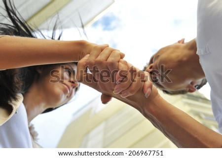 Friendly handshake young couple. - stock photo