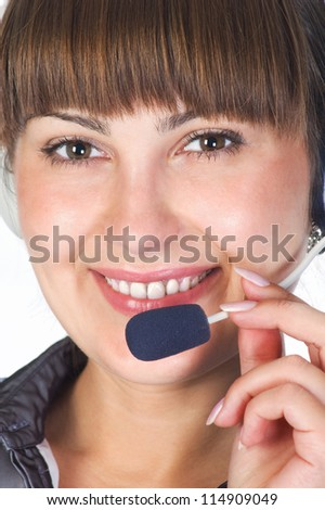 Friendly helpdesk girl.Portrait of a happy young woman wearing headphones. - stock photo