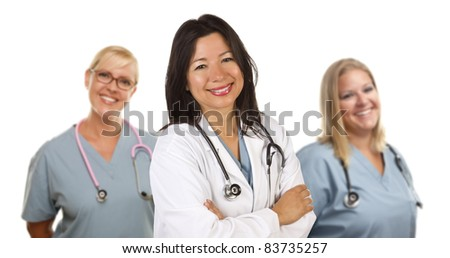 Friendly Hispanic Female Doctor and Colleagues Behind Isolated on a White Background.