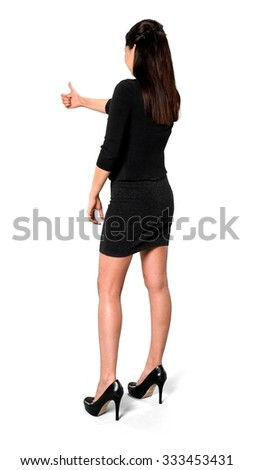 Friendly Hispanic young woman with long dark brown hair in casual outfit giving thumbs up - Isolated