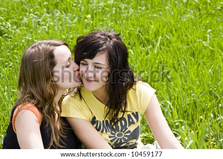 Friendly kiss between two young women