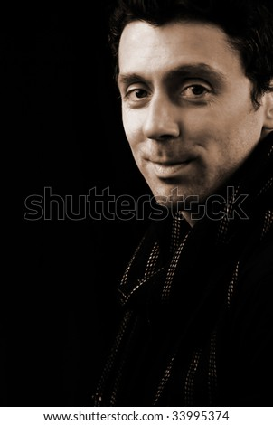Friendly looking man with a scarf - Black and white - stock photo