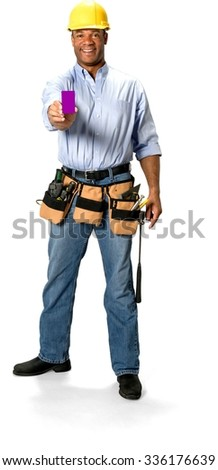 Friendly Male Construction Worker with short black hair in uniform holding business card - Isolated - stock photo