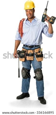 Friendly Male Construction Worker with short black hair in uniform holding driller - Isolated - stock photo