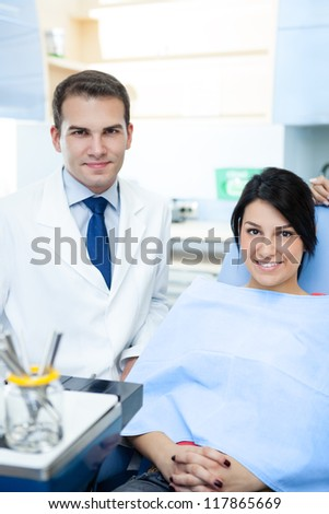 Friendly male dentist and patient - stock photo