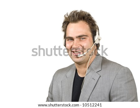 Friendly man in call center - stock photo