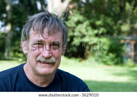 friendly man in his fifties with graying hair - stock photo