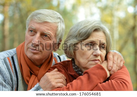 Friendly Mature couple spending time outdoor in the park