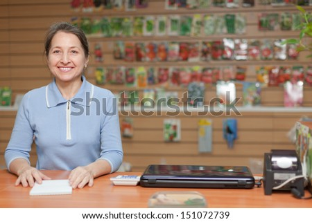 friendly mature saleswoman at shop for gardener