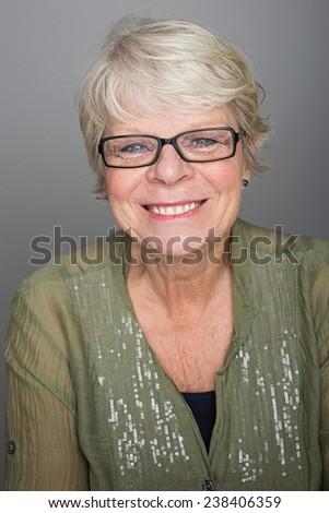 Friendly mature woman - stock photo