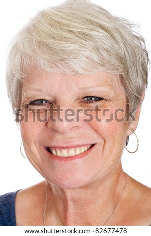 Friendly, mature woman with a pretty smile. - stock photo