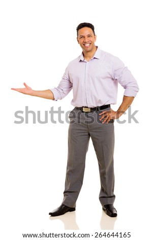 friendly middle aged businessman doing welcome gesture on white background - stock photo