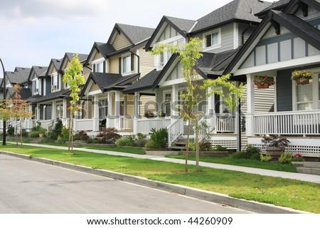 Friendly neighborhood of townhouses. - stock photo