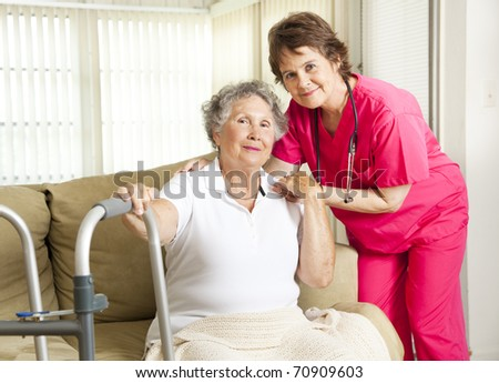 Friendly nurse cares for an elderly woman in a nursing home. - stock photo