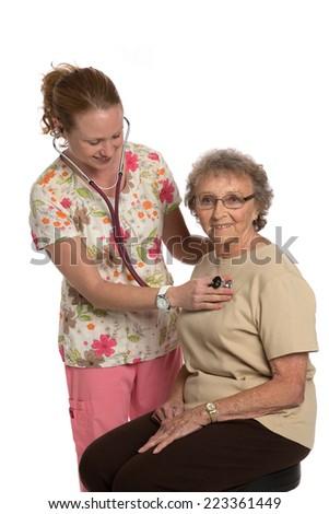 Friendly Nurse Check Elderly Senior Isolated on White Background - stock photo