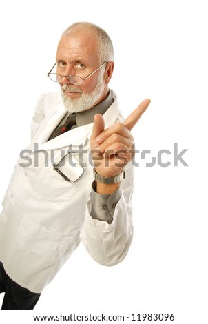 Friendly older doctor pointing at copy space to his right - stock photo