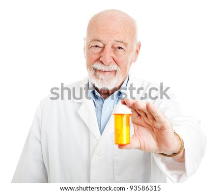 Friendly pharmacist holding a bottle of pills.  Isolated on white. - stock photo