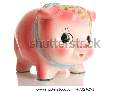 Friendly piggy bank, studio isolated on white.