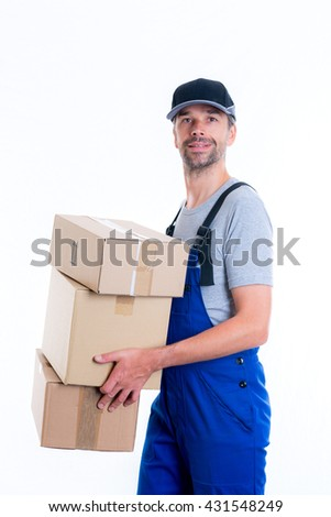 friendly postman with parcels in front of white background - stock photo
