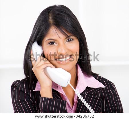friendly receptionist on phone - stock photo