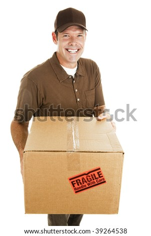 Friendly, smiling delivery man bringing a fragile package.  Isolated on white. - stock photo