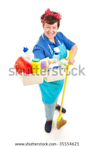 Friendly smiling maid holding a tray of cleaning products.  Full body isolated on white. - stock photo