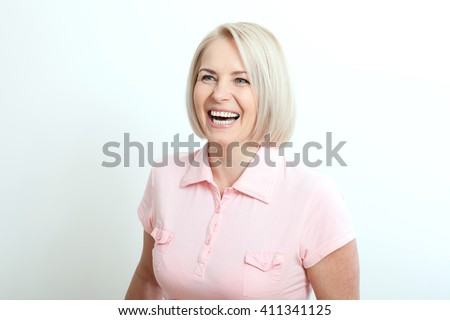 Friendly smiling middle-aged woman isolated on white background - stock photo